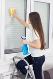 Young Woman Cleaning Windows Glass Stock Photos