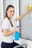 Young Woman Cleaning Windows Glass Royalty Free Stock Photos