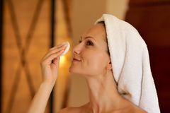 Young woman cleansing her face Stock Images
