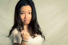Young woman clenching her fist Stock Photo