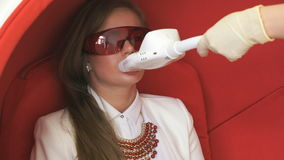 Young woman client at teeth whitening procedure stock video