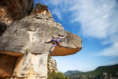 Young woman climber on a cliff Stock Photo