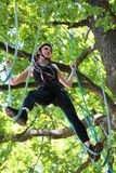 Young woman climbing in adventure rope park Royalty Free Stock Photo