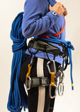 Young woman in climbing equipment on white background Stock Images