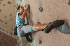 Young woman climbing indoor Stock Photo