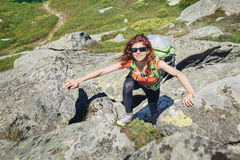 Young woman climbing in the mountain Stock Photography