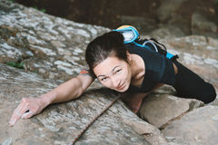 Young woman climbing outdoor Stock Images