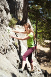Young woman is climbing Royalty Free Stock Images