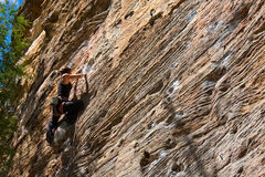 Young woman climbing. Rock climber ascending a sport route in Red River Gorge, Kentucky, on some wonderful sandstone Stock Photos