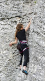 Young woman climbing rock. Stock Images