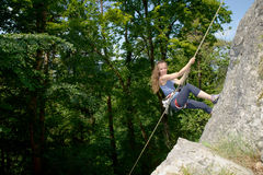 Young woman climbing a rock wall Royalty Free Stock Photo