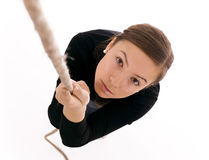 Young woman climbing on rop Royalty Free Stock Photo