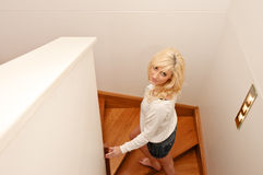 Young woman climbing stairs Royalty Free Stock Photos