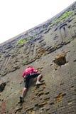 Young woman climbing up Stock Photo