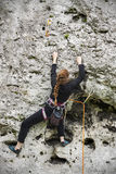 Young woman climbing. Stock Photography