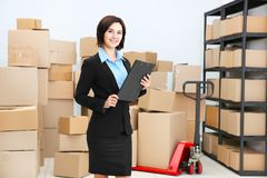Young woman with clipboard in logistics company stock photography