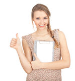 Young woman with clipboard, thumb up Royalty Free Stock Image