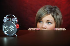 Young woman with clock. Royalty Free Stock Photo