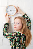 Young woman and clock Stock Image