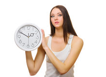 Young woman with clock Royalty Free Stock Images