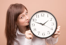 Young woman with clock Royalty Free Stock Photo