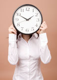Young woman with clock Stock Image