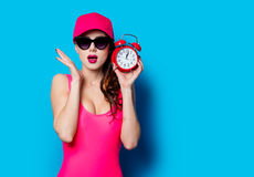 Young woman with clock Stock Images
