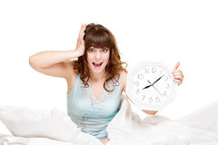 Young woman with clock in panic Royalty Free Stock Photos