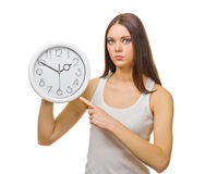 Young woman with clocks Stock Photo