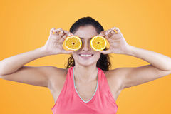 Young woman close her eyes with orange slices Royalty Free Stock Photo