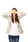 Young woman close her`s eyes with hands royalty free stock images