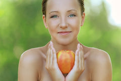 Young woman close up with big apple Stock Photography