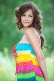 Young woman close-up in colorful dress Stock Photos