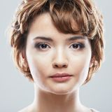 Young woman close up face beauty portrait.Short Hair style. Fem. Ale model isolaed white background royalty free stock images