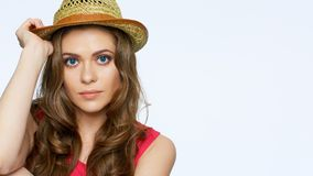 Young woman close up face portrait with yellow hat. Stock Photos