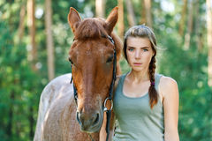 Young woman close-up with horse Stock Photo