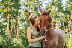 Young woman close-up with horse Royalty Free Stock Images
