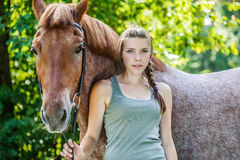 Young woman close-up with horse Royalty Free Stock Photos