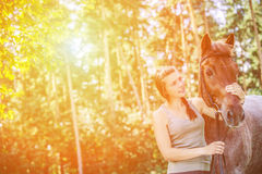 Young woman close-up with horse Stock Image