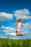 Young woman close-up jumping Stock Photos