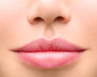 Young woman close up. Sexy plump lips Stock Photography