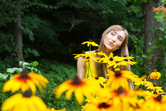 Young woman close up in the woods with flowers Royalty Free Stock Photography