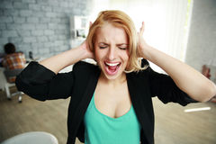 Young woman with closed ears Stock Images