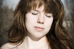 Young woman with closed eye Stock Images