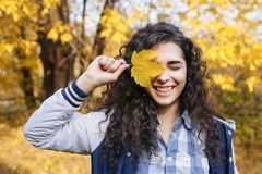 Young woman closed eye with autumn leaf Stock Photo