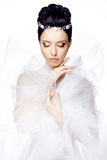 Young woman with closed eyes isolated on white studio background dressed in the cape of organza and beautiful tiara Stock Photography