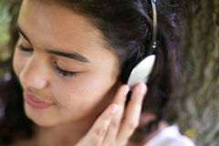 Young Woman With Closed Eyes Listening To Music Royalty Free Stock Photos