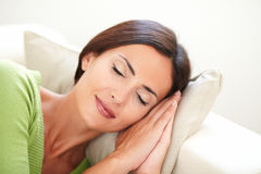 Young woman with closed eyes lying down Stock Photos
