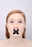 Young woman with the closed mouth Royalty Free Stock Photos