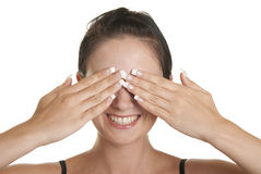 Young woman closes eyes palms stock photography